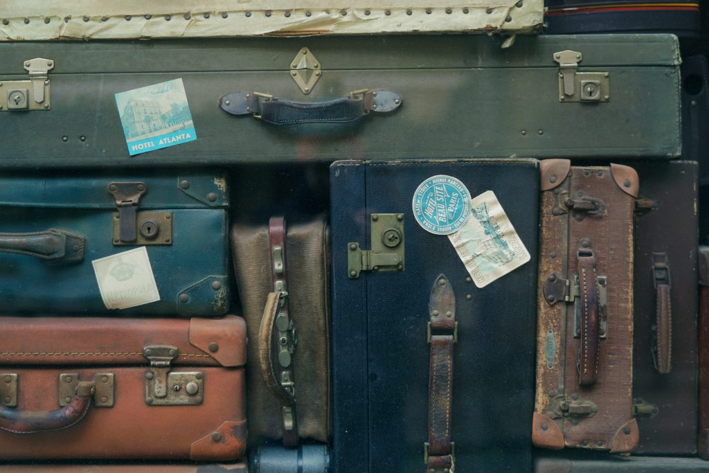 Canva-Stack-of-Old-Suitcases-1024x683